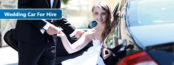 bride coming out of a wedding car